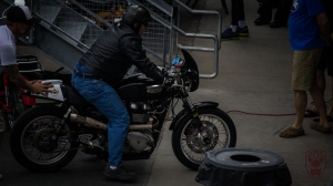Triumph being pushed into garage